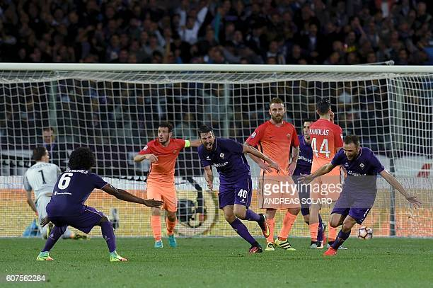 Fiorentina's midfielder from Croatia Milan Badelj reqcts after scoring against AS Roma during the Italian Serie A football match Fiorentina vs Roma...
