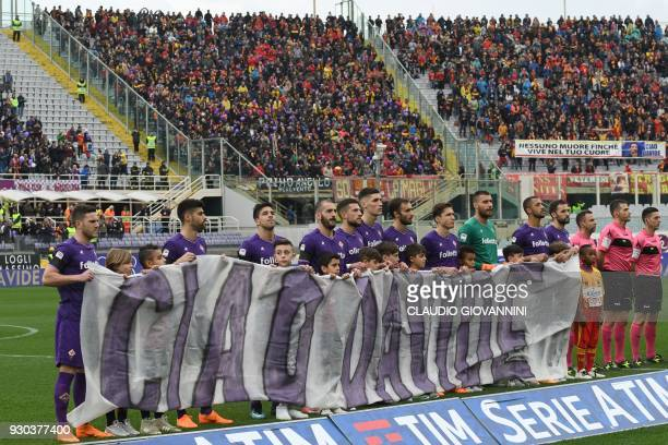 Fiorentina's player hold a banner 'Ciao Davide' to pay tribute to late Fiorentina's captain Davide Astori on March 11 2018 during the Italian Serie A...