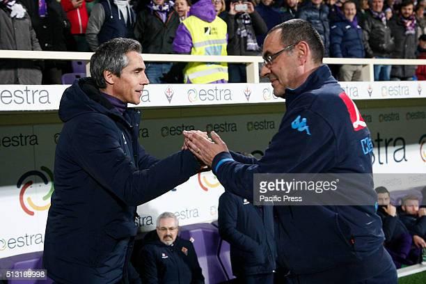 Fiorentina's Portuguese coach Paulo Sousa greets Napoli's Italian coach Maurizio Sarri before the Italian Serie A Football League match ACF...