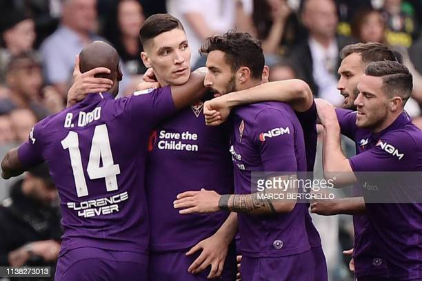 Fiorentina's Serbian defender Nikola Milenkovic celebrates with teammates after opening the scoring during the Italian Serie A football match...