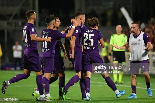 Fiorentina's Serbian defender Nikola Milenkovic celebrates with teammates and Fiorentina's French forward Franck Ribery after scoring during the...