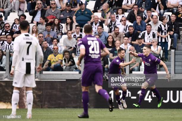 Fiorentina's Serbian defender Nikola Milenkovic celebrates with Fiorentina's Slovak defender David Hancko after opening the scoring during the...