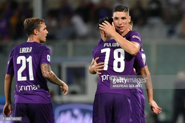Fiorentina's Serbian defender Nikola Milenkovic celebrates with Fiorentina's Chilean midfielder Erick Pulgar after scoring during the Italian Serie A...
