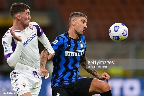 Fiorentina's Serbian forward Dusan Vlahovic and Inter Milan's Serbian defender Aleksandar Kolarov go for the ball during the Italian Serie A football...