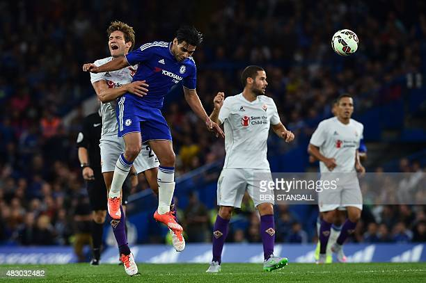 Fiorentina's Spanish defender Marcos Alonso contests a header with Chelsea's Colombian striker Radamel Falcao during the preseason friendly...