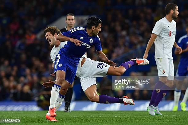 Fiorentina's Spanish defender Marcos Alonso goes down after contesting a header with Chelsea's Colombian striker Radamel Falcao during the preseason...