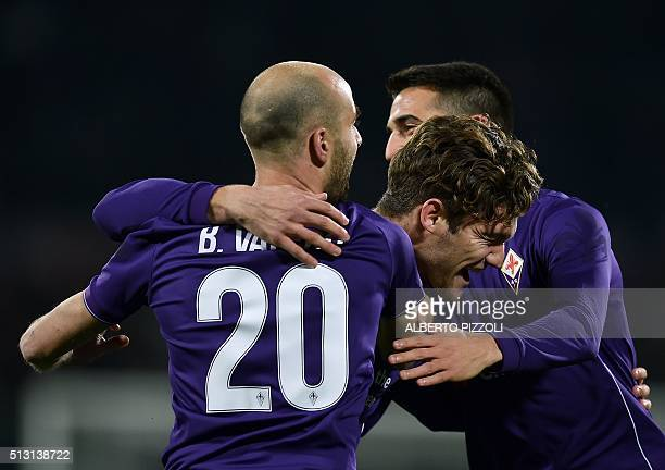 Fiorentina's Spanish defender Marcos Alonso Mendoza celebrates with teammates after scoring a goal during the Italian Serie A football match between...