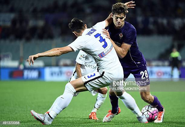 Fiorentina's Spanish defender Marcos Alonso Mendoza vies with Atalanta's Brazilian defender Rafael Toloi during the Italian Serie A football match...