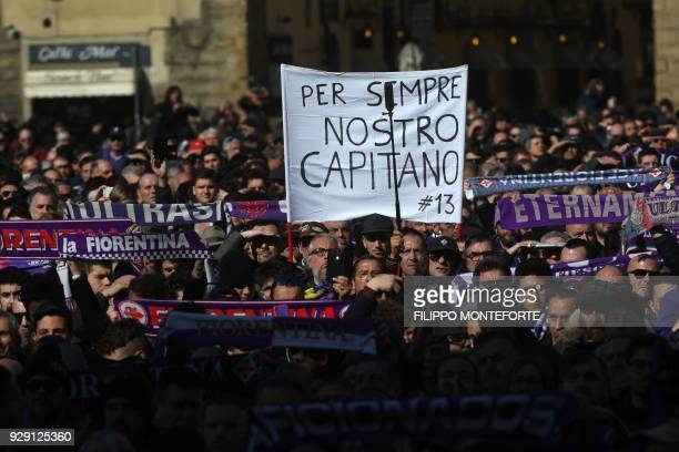 TOPSHOT Fiorentina's supporters attend the funeral of Fiorentina's captain Davide Astori on March 8 2018 in Florence Italian player Davide Astori...