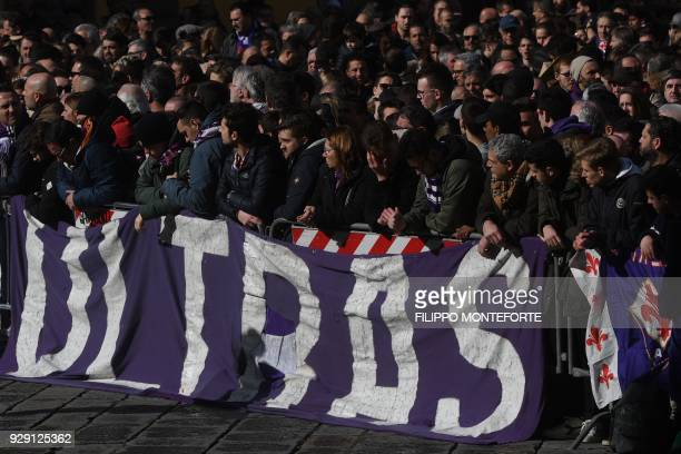Fiorentina's supporters attend the funeral of Fiorentina's captain Davide Astori on March 8 2018 in Florence Italian player Davide Astori likely died...