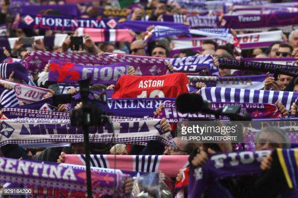 Fiorentina's supporters pay homage to Fiorentina's captain Davide Astori as his coffin is carried out of Santa Croce basilica at the end of the...