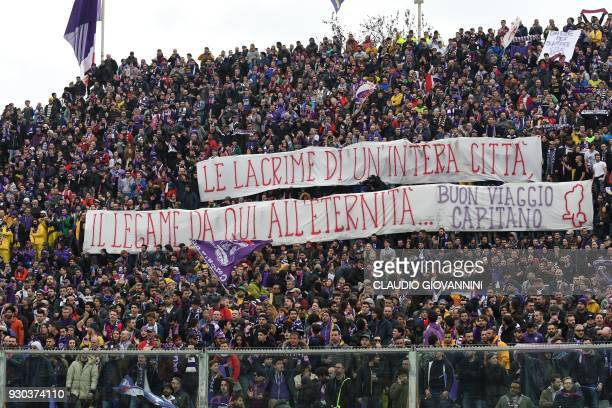 Fiorentina's supporters pay tribute to late Fiorentina captain Davide Astori with giant banners on March 11 2018 before the Italian Serie A football...