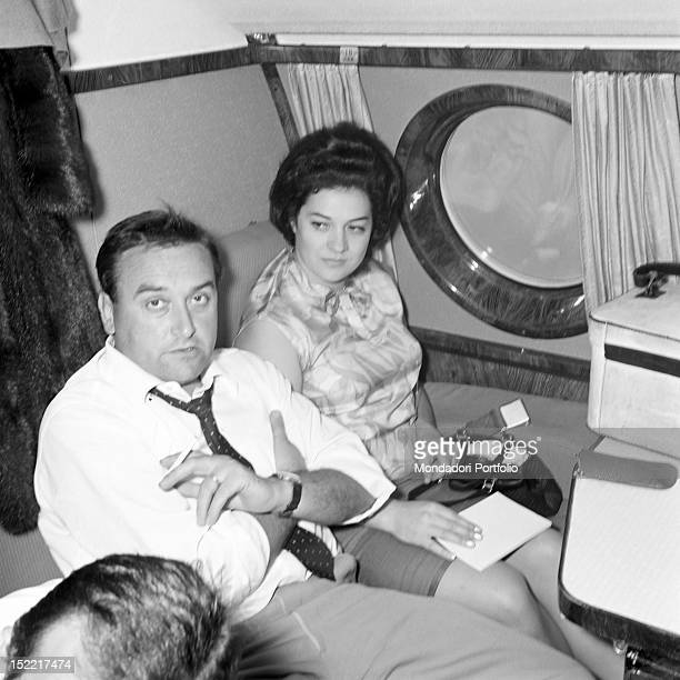 Fiorenza Cossotto next to Ivo Vinco on an plane September 1964