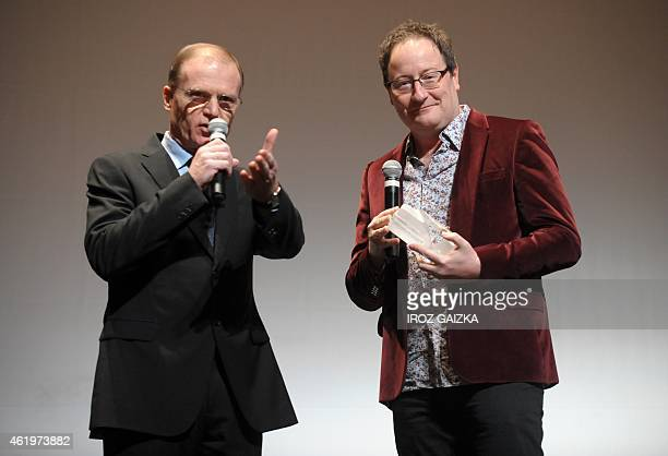 Fipa representative Francois Sauvagnargues speaks after awarding British Chris Chibnall creator of 'Broadchurch' with a 'Eurofipa honor' in Biarritz...
