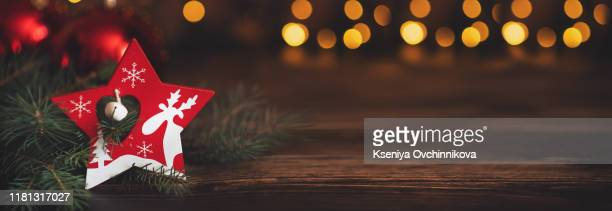 fir branch with balls and festive lights on the christmas background with sparkles. - christmas banner stock photos and pictures