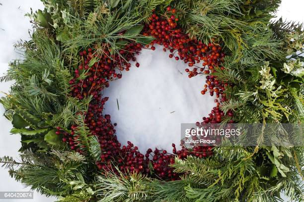 Fir, Holly, and Red Christmas Berry Wreath on Snow