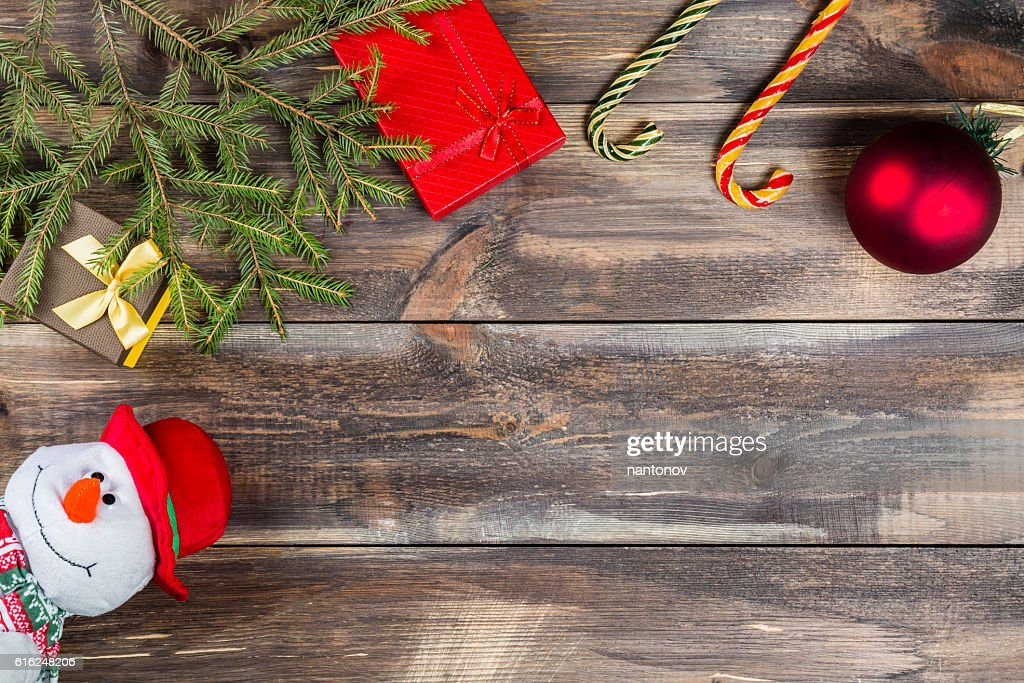 Fir tree branches with gift box, cane candies, christmas ball : Stock Photo
