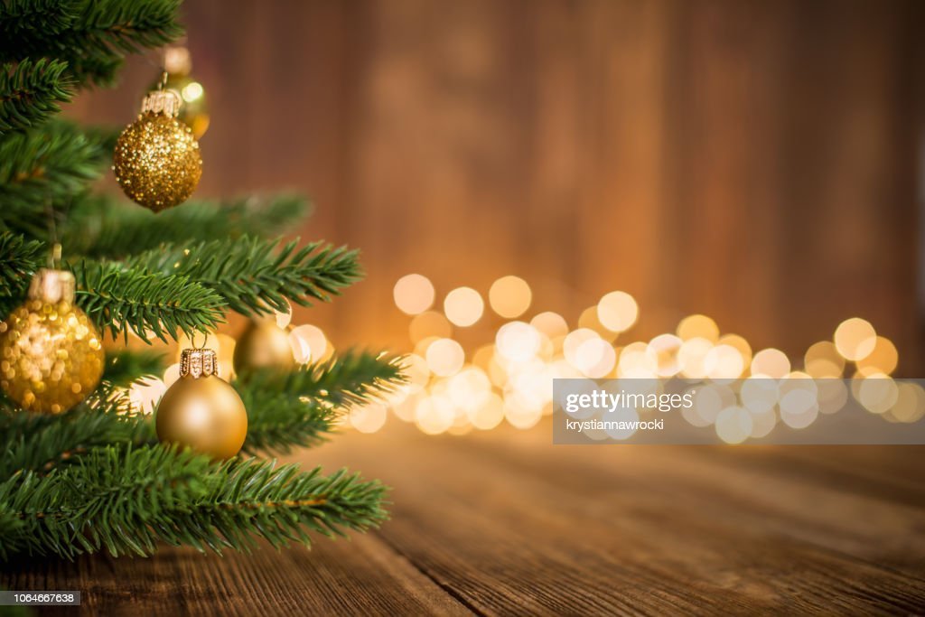 Fir Tree decorated with christmas balls on rustic wood and sparkles light backgorund : Stock Photo