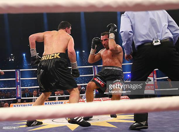 Firat Arslan of Germany is knocked down by Marco Huck of Germany during their WBO Cruiserweight title fight at HansMartinSchleierHalle on January 25...