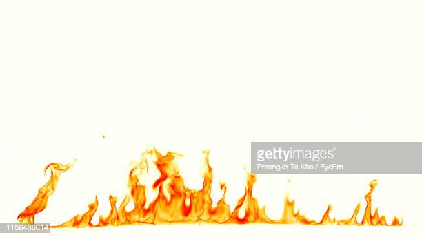 fire against white background - flame stock pictures, royalty-free photos & images