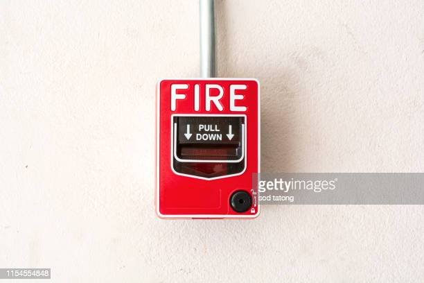fire alarm next to the walkway around the office building - evacuation stock pictures, royalty-free photos & images