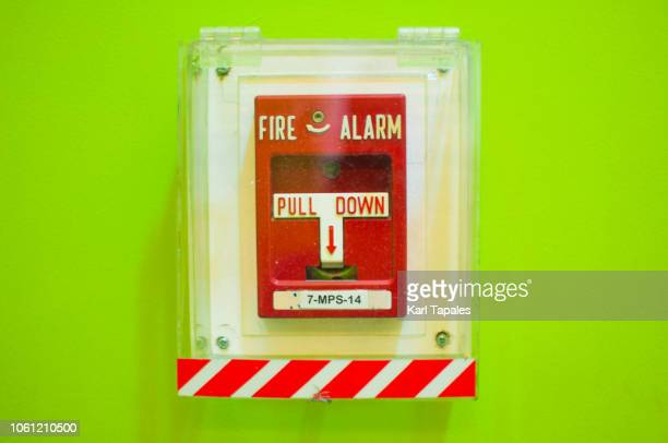 fire alarm on a neon green background - capital region stock pictures, royalty-free photos & images