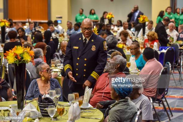 Fire and EMS Chief Gregory Dean chats with Marva Jones, 2nd from L, and Daniel Cuthbert as seniors displaced by the devastating fire at the Arthur...