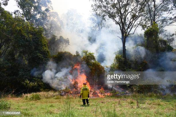 Fire and Rescue crews light controlled back burns on November 21, 2019 in St Albans, Australia. Most of NSW remains under severe or very high fire...