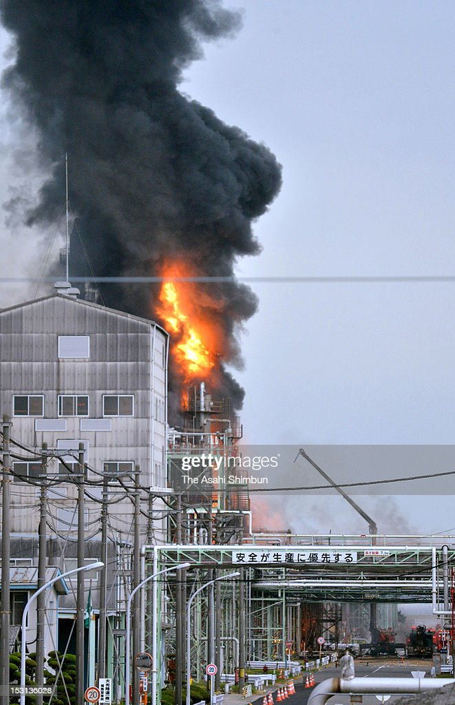 Fire and smoke arise from Nippon Shokubai Himeji factory on September 29, 2012 in Himeji, Hyogo, Japan. A firefighter was killed by being involved in the second explosion.