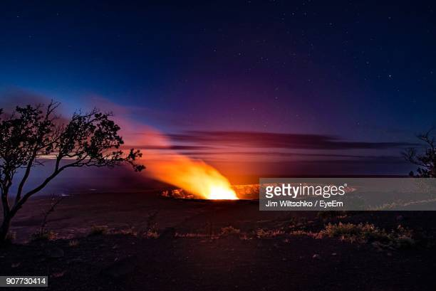 fire and smoke emitting from crater against sky at night - キラウエア火山 ストックフォトと画像