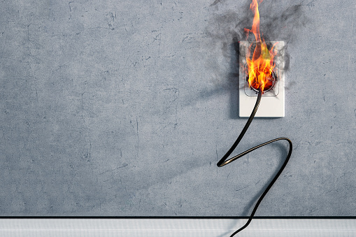 fire and smoke on electric wire plug in indoor, electric short circuit causing fire on plug socket 896676620
