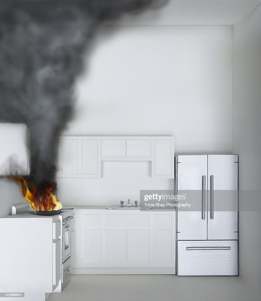 Kitchen Stove Fire: Fire And Smoke On Stove In Kitchen Of Model House Stock