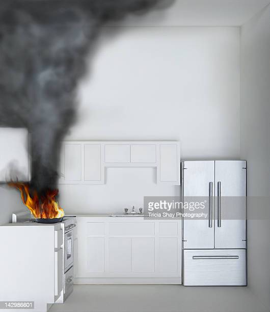 Fire and smoke on stove in kitchen of model house