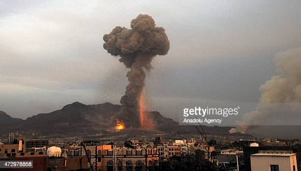 Fire and smoke rise after Saudi-led warplanes bombed weapon storage sites held by Shiite Houthi militant group in Yemeni capital Sanaa on May 11,...