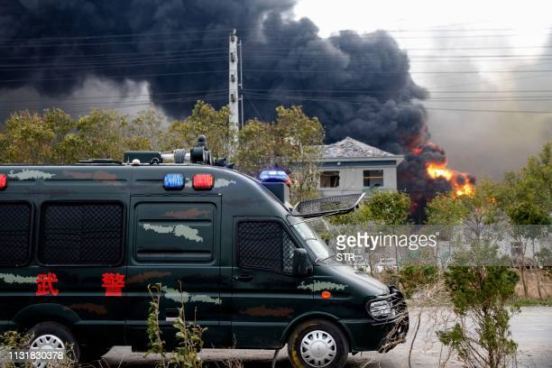 Fire and smoke rise at an explosion site in Yancheng in China's eastern Jiangsu province on March 21 2019 A huge explosion rocked a chemical plant in...