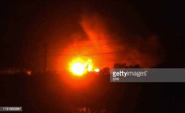 TOPSHOT Fire and smoke rise from the site of an explosion in Yancheng in China's eastern Jiangsu province on March 21 2019 A huge explosion rocked a...