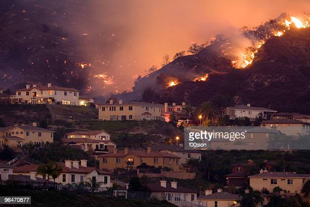 fire approaching homes in california - california stock pictures, royalty-free photos & images