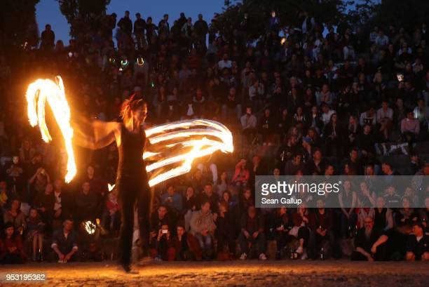 A fire artist performs at Mauerpark on Walpurgis night on April 30 2018 in Berlin Germany Walpurgis is traditionally the night of witches in Germany
