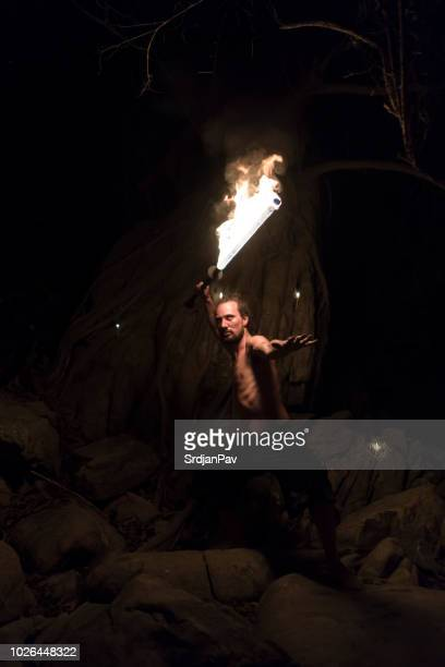 fire attack - sword in the stone stock photos and pictures