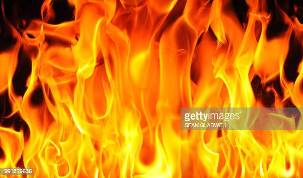 fire background - furious stock pictures, royalty-free photos & images