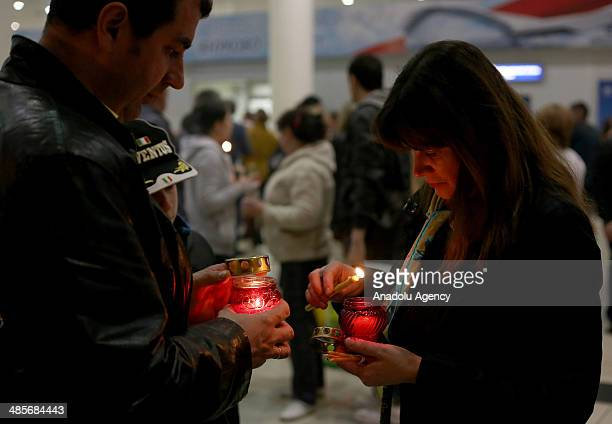 Fire believed as holy and brought from Jerusalem in a special box to the Vnukovo International Airport is distributed to churches in Moscow Russia on...