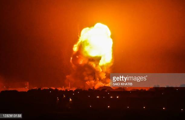 Fire billows from Israeli air strikes in Rafah, in the southern Gaza Strip, on May 11, 2021. - Israel launched deadly air strikes on Gaza on May 10...