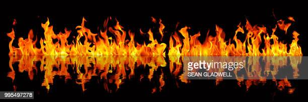 fire blaze reflection - hell stock pictures, royalty-free photos & images