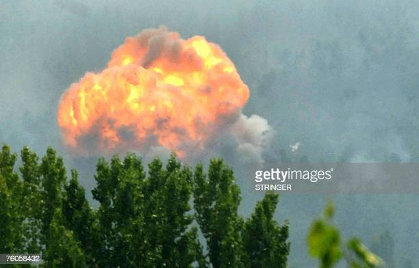 A fire blazes at a major Indian Army ammunition depot in Khandroo some 88 kms south of the summer capital Srinagar 11 August 2007 A huge fire broke...
