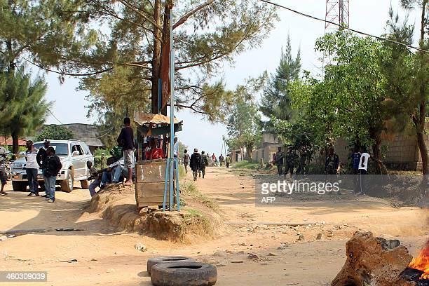 REPEAT A fire blocks a road as hundreds of people demonstrated to protest against the death of Colonel Mamadou Ndala on January 3 2014 in Beni...