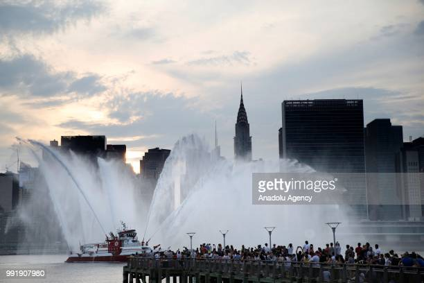 FDNY fire boat puts on a water show during the Independence Day celebrations at the East River in New York United States on July 4 2018