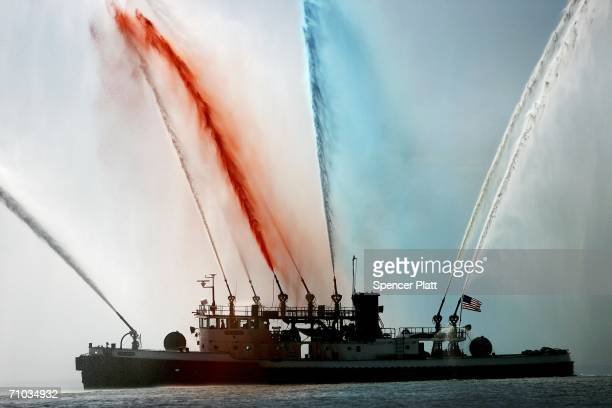 A fire boat welcomes ships into New York harbor during Fleet Week May 24 2006 in New York City Sailors Marines and Coast Guardsmen will sail into New...
