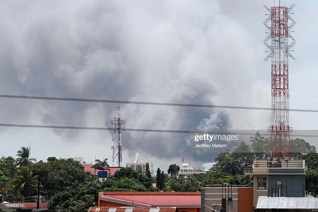 A fire breaks out as fighting resumed on September 18, 2013 in Zamboanga, Philippines. Around 100 have been killed, six of them from the military, three from police and seven civilians, as a stand off between Muslim rebels and state security forces has resumed. The military said the rebels, numbering 30 to 40, are still holding dozens of hostages. The conflict that started on September 9, 2013 came weeks after Nur Misuari, the leader and founder of the Moro National Liberation Front, declared the independence of Mindanao. His group signed a peace accord with government in 1996.