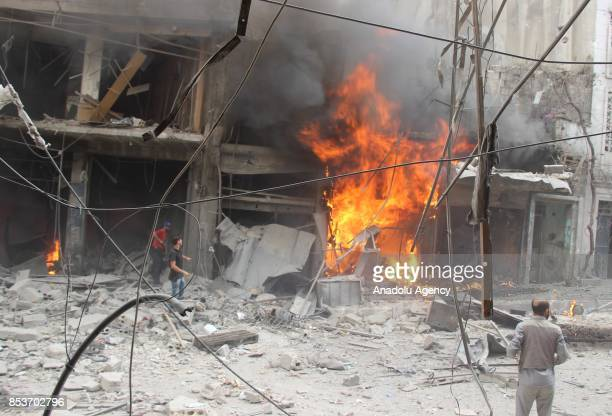 Fire breaks out at a store after Assad Regime's forces carried out air strikes over the deconflict zone at the Jisr alShughur district of Idlib Syria...