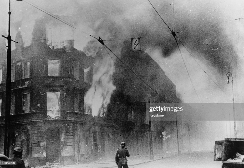 Fire breaks out during the Warsaw Ghetto Uprising, a Polish insurrection against the German forces who had occupied Poland at the start of World War II. By 1944 Warsaw was the centre of Polish resistance, but the army was forced to surrender on October 2nd 1944 under pressure from German air raids.